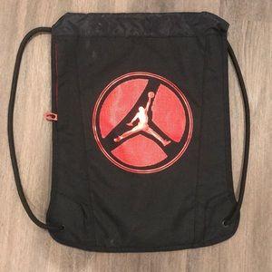 Jordan Drawstring Bag Black and Red Nylon material